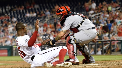 <p>               Washington Nationals' Victor Robles, left, slides home to score against St. Louis Cardinals catcher Yadier Molina, right, during the fifth inning of a baseball game on a double by Adam Eaton, Wednesday, Sept. 5, 2018, in Washington. (AP Photo/Nick Wass)             </p>