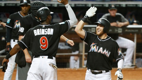 <p>               Miami Marlins' Lewis Brinson (9) congratulates Austin Dean after Dean hit a home run also scoring Brinson during the sixth inning of a baseball game against the Cincinnati Reds, Saturday, Sept. 22, 2018, in Miami. (AP Photo/Wilfredo Lee)             </p>