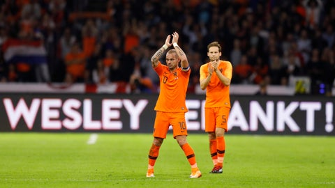 """<p>               A billboard reads """"Wesley Thank You"""" as Wesley Sneijder of The Netherlands acknowledges the applause after he was substituted during the international friendly soccer match between The Netherlands and Peru at the Johan Cruijff ArenA in Amsterdam, Netherlands, Thursday, Sept. 6, 2018. The friendly against Peru is the 134th and last for 34-year-old Sneijder, a Dutch record. His first international was a 1-1 draw with Portugal on April 30, 2003. The attacking midfielder has played for clubs including Ajax, Real Madrid and Inter Milan. (AP Photo/Peter Dejong)             </p>"""