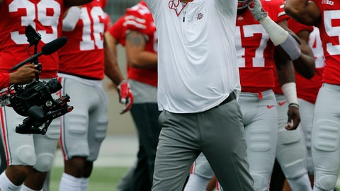 <p>               Ohio State head coach Urban Meyer greets players during their warm before an NCAA college football game against Tulane Saturday, Sept. 22, 2018, in Columbus, Ohio. Meyer is returning to his coaching duties after a three-game suspension. (AP Photo/Jay LaPrete)             </p>