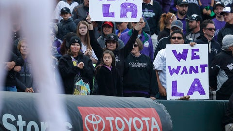 <p>               Fans hold up signs in the ninth inning of a baseball game as the Colorado Rockies host the Washington Nationals Sunday, Sept. 30, 2018, in Denver. The Rockies won 12-0 and advance to a playoff game for the National League Western Division title against the Los Angeles Dodgers. (AP Photo/David Zalubowski)             </p>