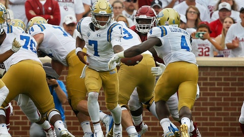 <p>               UCLA quarterback Dorian Thompson-Robinson (7) hands off to running back Bolu Olorunfunmi (4) in the second half of an NCAA college football game in Norman, Okla., Saturday, Sept. 8, 2018. Oklahoma won 49-21. (AP Photo/Sue Ogrocki)             </p>