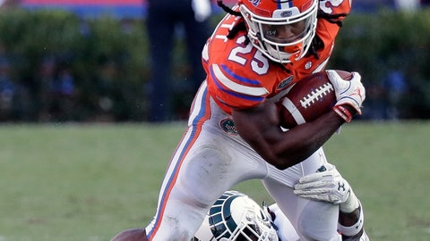<p>               Florida running back Jordan Scarlett (25) is stopped by Colorado State linebacker Tre Thomas during the second half of an NCAA college football game, Saturday, Sept. 15, 2018, in Gainesville, Fla. (AP Photo/John Raoux)             </p>
