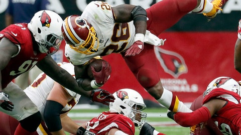 <p>               Washington Redskins running back Adrian Peterson (26) is hit as Arizona Cardinals defensive end Benson Mayowa (91) pursues during the second half of an NFL football game, Sunday, Sept. 9, 2018, in Glendale, Ariz. (AP Photo/Rick Scuteri)             </p>