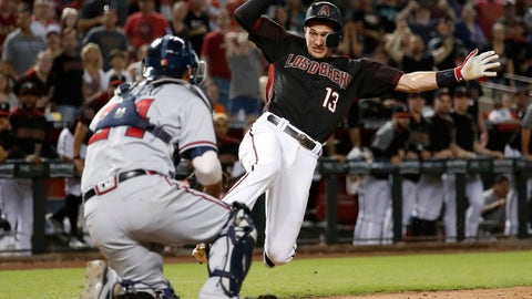 <p>               Arizona Diamondbacks Nick Ahmed (13) is tagged out at the plate by Atlanta Braves catcher Kurt Suzuki to end the baseball game Saturday, Sept. 8, 2018, in Phoenix. The Braves won 5-4 in 10 innings. (AP Photo/Matt York)             </p>