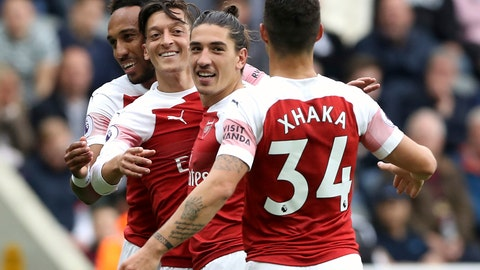 <p>               Arsenal's Mesut Ozil, centre, celebrates scoring his side's second goal of the game with teammates, during the English Premier League soccer match between Newcastle United and Arsenal at St James' Park, in Newcastle, England, Saturday, Sept. 15, 2018. (Owen Humphreys/PA via AP)             </p>