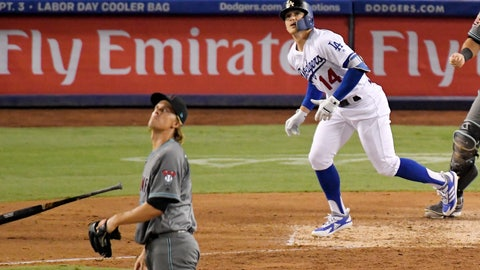 <p>               Los Angeles Dodgers' Enrique Hernandez runs to first after hitting a solo home run off Arizona Diamondbacks starting pitcher Zack Greinke, left, during the seventh inning of a baseball game Friday, Aug. 31, 2018, in Los Angeles. (AP Photo/Mark J. Terrill)             </p>