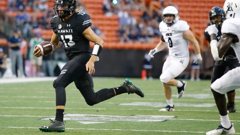 <p>               Hawaii quarterback Cole McDonald (13) runs through the Rice defense during the first quarter of an NCAA college football game Saturday, Sept. 8, 2018, in Honolulu. (AP Photo/Marco Garcia)             </p>