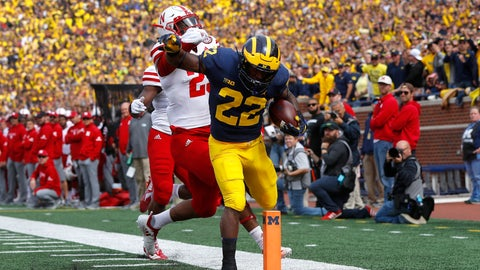 <p>               Michigan running back Karan Higdon (22) scores on a 44-yard run as Nebraska defensive back Antonio Reed (25) defends in the first half of an NCAA football game in Ann Arbor, Mich., Saturday, Sept. 22, 2018. (AP Photo/Paul Sancya)             </p>