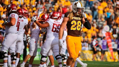 <p>               Wyoming safety Andrew Wingard, right, walks away as Washington State players celebrate in the end zone after scoring a touchdown during the first half of an NCAA college football game Saturday, Sept. 1, 2018, in Laramie, Wyo. (Shannon Broderick/Laramie Boomerang via AP)             </p>