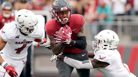 <p>               Eastern Washington defensive back Mitch Fettig (4) and defensive back Josh Lewis, right, tackle Washington State wide receiver Davontavean Martin during the first half of an NCAA college football game in Pullman, Wash., Saturday, Sept. 15, 2018. (AP Photo/Young Kwak)             </p>