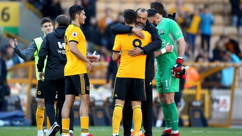 <p>               Wolverhampton Wanderers manager Nuno Espirito Santo hugs team member Ruben Neves after the final whistle of the game against Southampton during their English Premier League soccer match at Molineux stadium in Wolverhampton, England, Saturday Sept. 29, 2018. (Nick Potts/PA via AP)             </p>