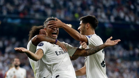 <p>               Real forward Mariano Diaz, center, celebrates with teammates after scoring his side's third goal during a Group G Champions League soccer match between Real Madrid and Roma at the Santiago Bernabeu stadium in Madrid, Spain, Wednesday Sept. 19, 2018. (AP Photo/Manu Fernandez)             </p>