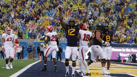 <p>               West Virginia wide receiver Gary Jennings Jr. (12) celebrates a touchdown during the first half of an NCAA college football game against Youngstown State on Saturday, Sept. 8, 2018, in Morgantown, W.Va. (AP Photo/Raymond Thompson)             </p>