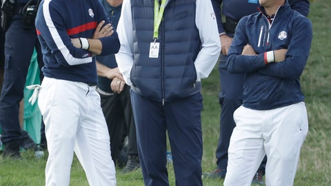 <p>               US team captain Jim Furyk, center, Jordan Spieth of the US, left, and Justin Thomas stand around the 8th green during a foursome match against Europe's Tommy Fleetwood and Europe's Francesco Molinari on the opening day of the 42nd Ryder Cup at Le Golf National in Saint-Quentin-en-Yvelines, outside Paris, France, Friday, Sept. 28, 2018. (AP Photo/Matt Dunham)             </p>
