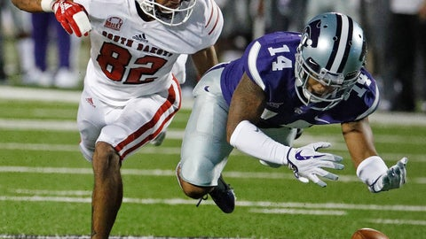 <p>               Kansas State defensive back Kevion McGee (14) breaks up a pass intended for South Dakota wide receiver Dakarai Allen (82) during the second half of an NCAA college football game Saturday, Sept. 1, 2018, in Manhattan, Kan. Kansas State won 27-24. (AP Photo/Charlie Riedel)             </p>