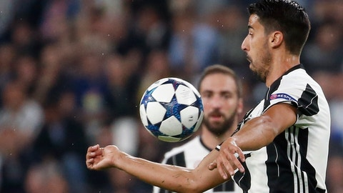 <p>               FILE - In this April 11, 2017 file photo, Juventus's Sami Khedira goes for the ball during a Champions League match between Juventus and Barcelona, at the Juventus Stadium in Turin, Italy. Germany midfielder Sami Khedira has extended his contract with Juventus for two more seasons. (AP Photo/Antonio Calanni)             </p>