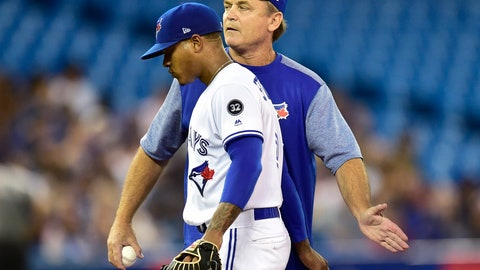 <p>               Toronto Blue Jays starting pitcher Marcus Stroman, left, is removed from a baseball game by manager John Gibbons, right, during second-inning against the Tampa Bay Rays in Toronto, Monday, Sept. 3, 2018. (Frank Gunn/The Canadian Press via AP)             </p>