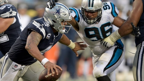 <p>               Dallas Cowboys' Dak Prescott (4) is chased by Carolina Panthers' Wes Horton (96) during the second half of an NFL football game in Charlotte, N.C., Sunday, Sept. 9, 2018. (AP Photo/Mike McCarn)             </p>