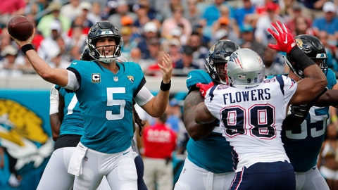 <p>               Jacksonville Jaguars quarterback Blake Bortles (5) throws a pass as he is pressured by New England Patriots defensive end Trey Flowers (98) during the first half of an NFL football game, Sunday, Sept. 16, 2018, in Jacksonville, Fla. (AP Photo/Stephen B. Morton)             </p>