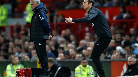 <p>               Derby County manager Frank Lampard gestures on the touchline with Manchester United manager Jose Mourinho, left, during their English League Cup, third round soccer match at Old Trafford in Manchester, England, Tuesday Sept. 25, 2018. (Martin Rickett/PA via AP)             </p>