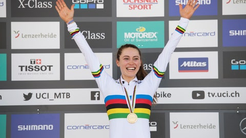 <p>               Kate Courtney from the U.S. celebrates with her  gold medal after winning the women's elite cross country olympic race at the UCI mountain bike World Championships in Lenzerheide, Switzerland., on Saturday, September 8, 2018. (Gian Ehrenzeller/Keystone via AP)             </p>