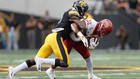 <p>               Iowa State running back David Montgomery (32) runs the ball as Iowa defensive back Michael Ojemudia makes the tackle during the first half of an NCAA college football game, Saturday, Sept. 8, 2018, in Iowa City, Iowa. (AP Photo/Matthew Putney)             </p>