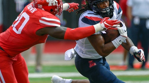 <p>               Arizona running back Gary Brightwell, right, is tackled by Houston linebacker Roman Brown during the first half of an NCAA college football game, Saturday, Sept. 8, 2018, in Houston. (AP Photo/Eric Christian Smith)             </p>