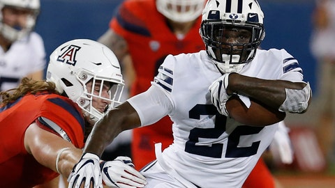 <p>               BYU running back Squally Canada (22) gets away from Arizona linebacker Colin Schooler during the first half of an NCAA college football game, Saturday, Sept. 1, 2018, in Tucson, Ariz. (AP Photo/Rick Scuteri)             </p>
