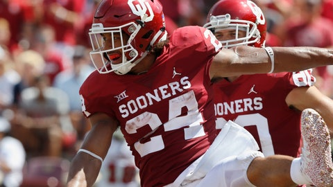 <p>               Oklahoma running back Rodney Anderson (24) celebrates a touchdown in the first half of an NCAA college football game against Florida Atlantic in Norman, Okla., Saturday, Sept. 1, 2018. (AP Photo/Sue Ogrocki)             </p>