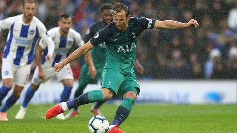 <p>               Tottenham Hotspur's Harry Kane scores his side's first goal of the game from the penalty spot against Brighton & Hove Albion during the English Premier League soccer match at the AMEX Stadium, Brighton, England, Saturday Sept. 22, 2018. (Steven Paston/PA via AP)             </p>