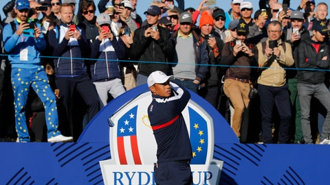 <p>               Spectators watch above as Tiger Woods of the US plays from the 1st tee during practice at Le Golf National in Guyancourt, outside Paris, France, Tuesday, Sept. 25, 2018. The 42nd Ryder Cup will be held in France from Sept. 28-30, 2018 at Le Golf National. (AP Photo/Francois Mori)             </p>