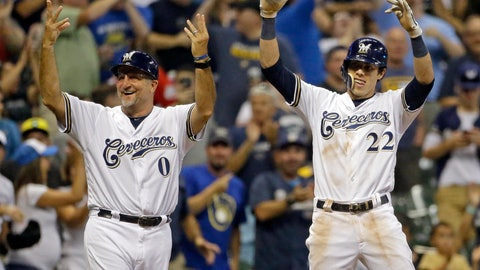 <p>               Milwaukee Brewers' Christian Yelich (22) celebrates with Ed Sedar (0) after hitting a two-RBI triple during the sixth inning of a baseball game against the Cincinnati Reds, Monday, Sept. 17, 2018, in Milwaukee. (AP Photo/Aaron Gash)             </p>