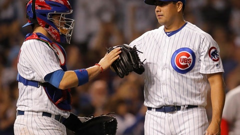 <p>               Chicago Cubs' Jorge De La Rosa, right, and Victor Caratini celebrate their win over the Cincinnati Reds at the end of a baseball game Friday, Sept. 14, 2018, in Chicago. (AP Photo/Jim Young)             </p>