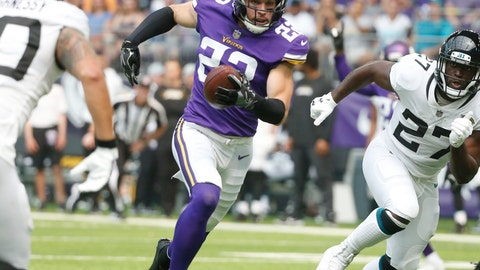 <p>               FILE - In this Aug. 18, 2018, file photo, Minnesota Vikings defensive back Harrison Smith (22) runs up field between Jacksonville Jaguars' James O'Shaughnessy, left, and Leonard Fournette, right, after intercepting a pass during the first half of an NFL preseason football game, in Minneapolis. The Vikings play at the Green Bay Packers on Sunday, Sept. 16. (AP Photo/Bruce Kluckhohn, File)             </p>
