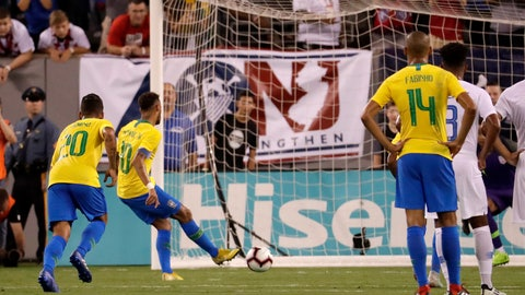 <p>               Brazil forward Neymar, second from left, kicks a penalty kick against the United States during the first half of an international soccer friendly match, Friday, Sept. 7, 2018, in East Rutherford, N.J. (AP Photo/Julio Cortez)             </p>