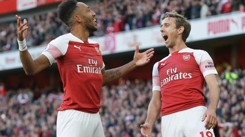 <p>               Arsenal's Pierre-Emerick Aubameyang, left celebrates with Arsenal's Nacho Monreal after scoring his side's 2nd goal during an English Premier League soccer match between Arsenal and Everton at the Emirates Stadium in London, Sunday Sept. 23, 2018. (AP Photo/Tim Ireland)             </p>