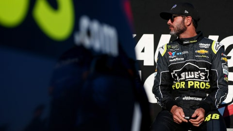 WATKINS GLEN, NY - AUGUST 04:  Jimmie Johnson, driver of the #48 Lowe's for Pros Chevrolet, sits on pit road wall during qualifying for the Monster Energy NASCAR Cup Series GoBowling at The Glen at Watkins Glen International on August 4, 2018 in Watkins Glen, New York.  (Photo by Sarah Crabill/Getty Images)