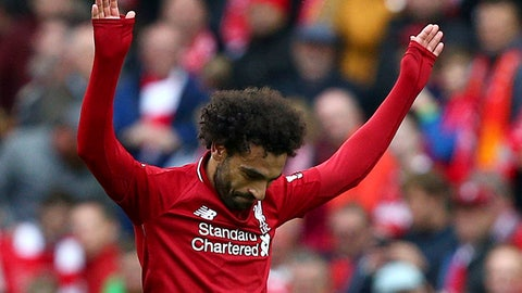 <p>               Liverpool's Mohamed Salah celebrates scoring his side's third goal of the game, during the English Premier League soccer match between Liverpool and Southampton, at Anfield, in Liverpool, England, Saturday, Sept. 22, 2018. (Dave Thompson/PA via AP)             </p>