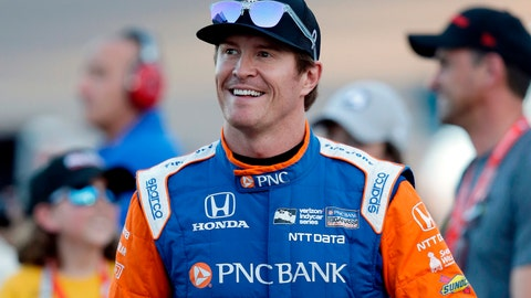 <p>               FILE - In this, April 7, 2018, file photo, driver Scott Dixon smiles before the IndyCar auto race at Phoenix International Raceway in Avondale, Ariz. Dixon has blazed his way through the record books to cement himself as the greatest IndyCar driver of his generation. One more championship will give him five, second in the open wheel record books only to A.J. Foyt.  (AP Photo/Rick Scuteri, File)             </p>