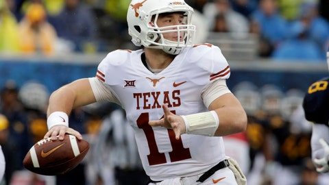 """<p>               FILE - In this Nov. 18, 2017, file photo, Texas quarterback Sam Ehlinger (11) throws a pass during the first half of an NCAA college football game against West Virginia in Morgantown, W.Va. Texas coach Tom Herman has said """"We have told Sam, launch that son of a gun, because that dude is really fast out there."""" (AP Photo/Raymond Thompson, File)             </p>"""
