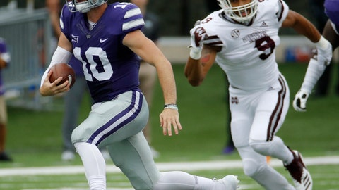 <p>               Kansas State quarterback Skylar Thompson (10) gets past Mississippi State defensive end Montez Sweat (9) as he runs the ball during the first half of an NCAA college football game Saturday, Sept. 8, 2018, in Manhattan, Kan. (AP Photo/Charlie Riedel)             </p>