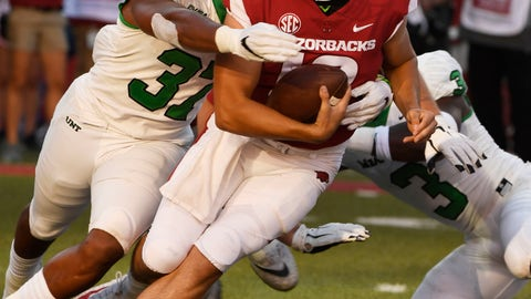 <p>               Arkansas quarterback Connor Noland is tackled by North Texas defender Brandon Garner in the second half of an NCAA college football game, Saturday, Sept. 15, 2018, in Fayetteville, Ark. (AP Photo/Michael Woods)             </p>