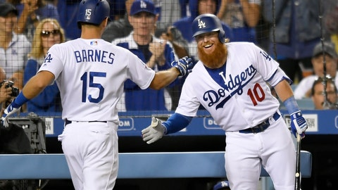 <p>               Los Angeles Dodgers' Austin Barnes,left, is congratulated by Justin Turner for his two-run home run during the fourth inning of a baseball game against the New York Mets on Tuesday, Sept. 4, 2018, in Los Angeles. (AP Photo/John McCoy)             </p>