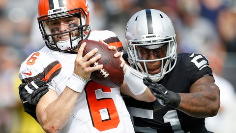 <p>               Cleveland Browns quarterback Baker Mayfield (6) tries to escape the grasp of Oakland Raiders defensive end Bruce Irvin (51) during the first half of an NFL football game in Oakland, Calif., Sunday, Sept. 30, 2018. (AP Photo/D. Ross Cameron)             </p>