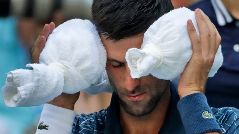 <p>               Novak Djokovic, of Serbia, puts an ice towel around his head during a changeover against Joao Sousa, of Portugal, during the fourth round of the U.S. Open tennis tournament, Monday, Sept. 3, 2018, in New York. (AP Photo/Carolyn Kaster)             </p>