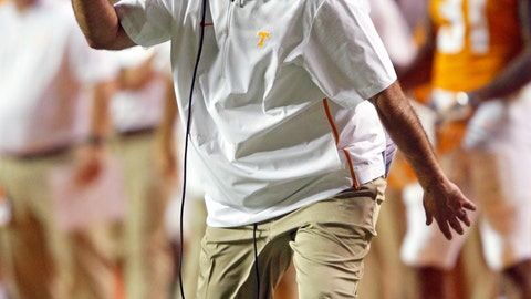 <p>               FILE - In this Sept. 22, 2018, file photo, Tennessee head coach Jeremy Pruitt directs his team during an NCAA college football game against Florida, in Knoxville, Tenn. Georgia head coach Kirby Smart says he sees the identity that Pruitt is trying to build at Tennessee as these two former Alabama defensive coordinators and ex-colleagues prepare to face off. (AP Photo/Wade Payne, File)             </p>