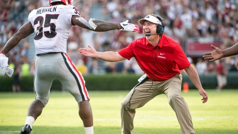<p>               Georgia head coach Kirby Smart celebrates with Brian Herrien (35) after Herrien's touchdown during the second half of an NCAA college football game against South Carolina, Saturday, Sept. 8, 2018, in Columbia, S.C. Georgia won 41-17. (AP Photo/Sean Rayford)             </p>
