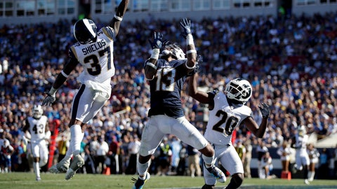 <p>               Los Angeles Rams defensive back Sam Shields, left, breaks up a pass intended for Los Angeles Chargers wide receiver Keenan Allen (13) as defensive back Lamarcus Joyner, right, looks on during the second half in an NFL football game Sunday, Sept. 23, 2018, in Los Angeles. (AP Photo/Jae C. Hong)             </p>