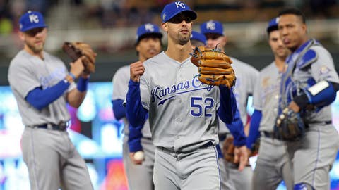 <p>               Kansas City Royals watch as pitcher Jorge Lopez, center, leaves after he was pulled in the ninth inning against the Minnesota Twins in a baseball game Saturday, Sept. 8, 2018, in Minneapolis. Lopez had a perfect game through eight innings but gave up a walk and a hit in the ninth. The Royals won 4-1. (AP Photo/Jim Mone)             </p>
